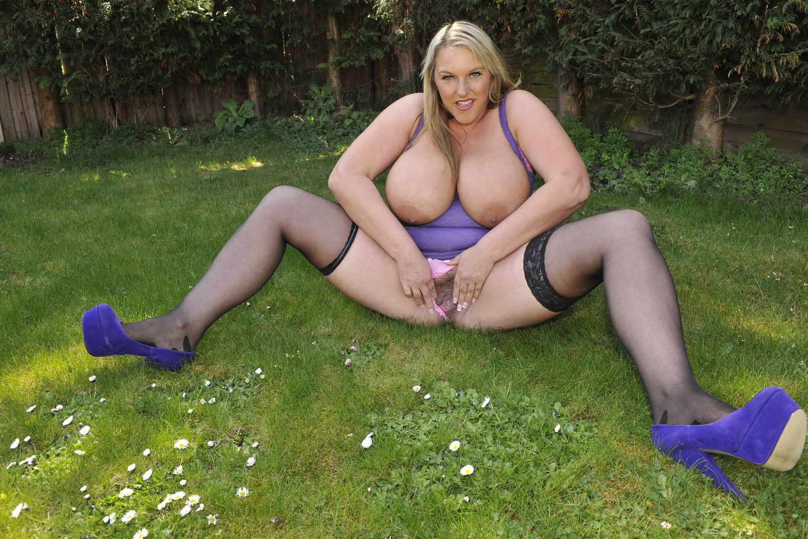 Mommy feeling horny in stockings so heads outdoors to show the boys her massive wet cunt.