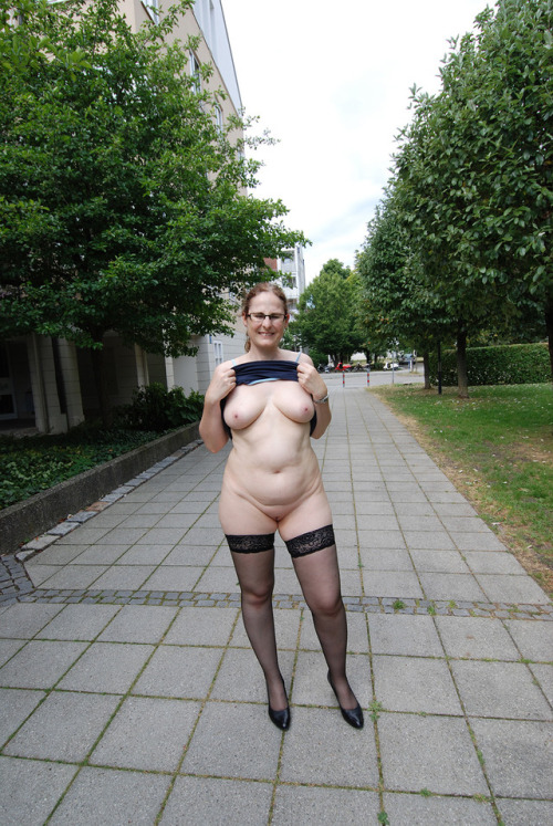 Amateur BBW housewife wearing just stockings and heels flashing in the middle of a high street.