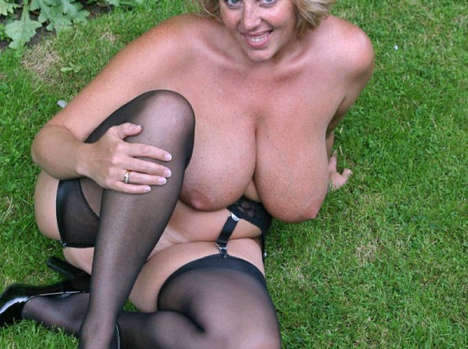 Buxom exhibitionist squats nude in the garden